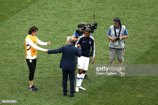 Didier Deschamps Manager of France shakes hands with Edinson Cavani of Uruguay following Uruguay's defeat during the 2018 FIFA World Cup Russia...