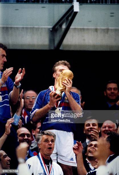 Didier Deschamps of France celebrate the victory with the trophy during the Soccer World Cup Final between Brazil and France on July 12 1998 in Paris...