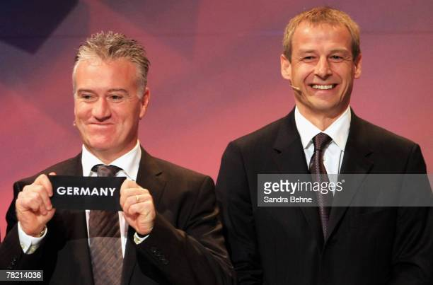 Didier Deschamps of France draws Germany while Juergen Klinsmann of Germany smiles during the UEFA EURO2008 Final Draw at the KKL on December 2 2007...