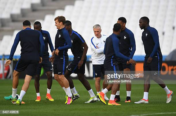 Didier Deschamps of France looks on as his team warm up during the France training session ahead of the UEFA Euro 2016 Group A match between France...