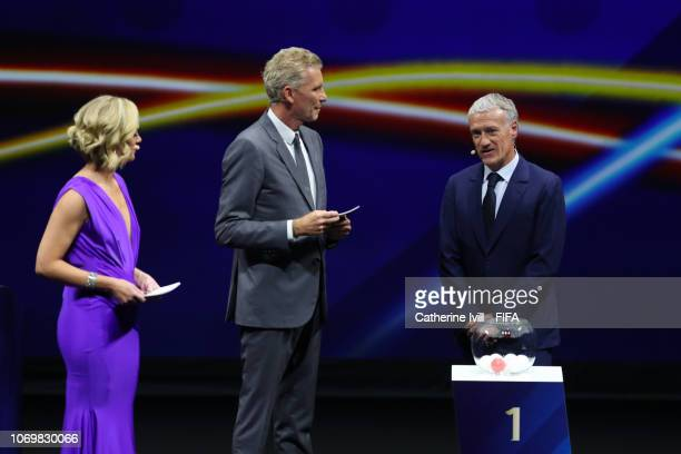 Didier Deschamps on stage with draw hosts Amanda Davies and Denis Brogniart during the FIFA Women's World Cup France 2019 Draw at La Seine Musicale...