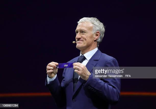 Didier Deschamps picks out the United States during the FIFA Women's World Cup France 2019 Draw at La Seine Musicale on December 8 2018 in Paris...