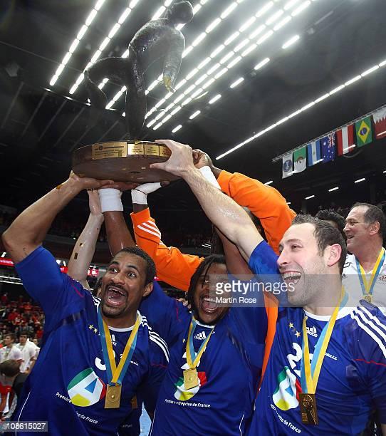 Didier Dinart Cedric Sorhaindo and Michael Guigou of France celebrate after winning the Men's Handball World Championship final match between France...