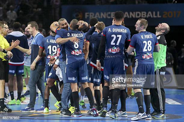 Didier Dinart Head Coach of France celebrates with Daniel Narcisse and the French team the victory of the 25th IHF Men's World Championship 2017 Semi...