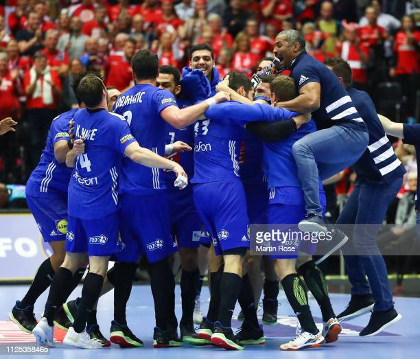 Didier Dinart, head coach of France jumps on the players of France as they celebrate winning at the end during the 26th IHF Men's World Championship...