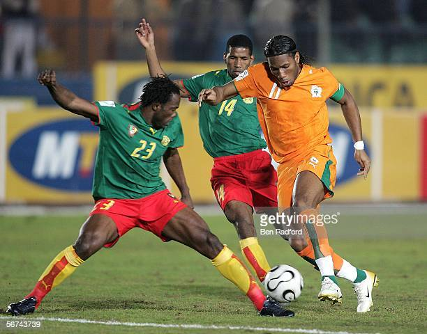 Didier Dogba of Ivory Coast in thwarted by Bikey Amougou Andre of Cameroon during The African Cup of Nations, Quarter Final match between Cameroon...