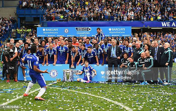 Didier Drogba and Chelsea players and staffs celebrate winning the Premier League title after the Barclays Premier League match between Chelsea and...