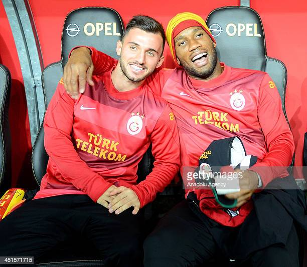 Didier Drogba and Emre Colak of Galatasaray are seen before the Turkish Super League match between Galatasaray and Sivasspor at Turk Telekom Arena on...