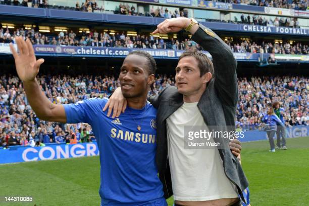 Didier Drogba and Frank Lampard of Chelsea applaud the fans during the Barclays Premier League match between Chelsea and Blackburn Rovers at Stamford...