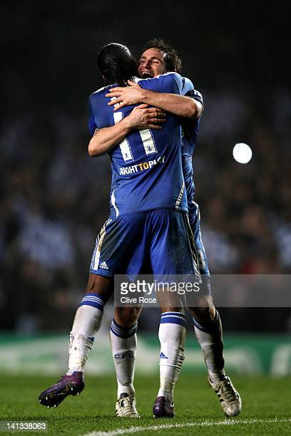 Didier Drogba and Frank Lampard of Chelsea celebrate their team's victory after the final whistle during the UEFA Champions League round of 16 second...