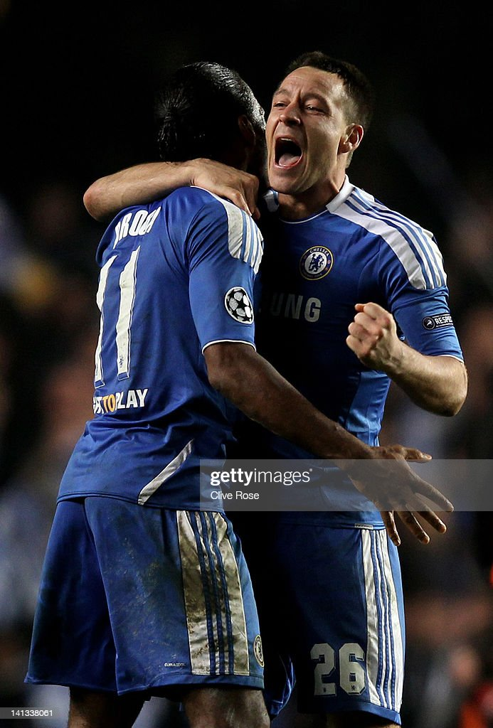 Didier Drogba and John Terry of Chelsea celebrate their team's victory after the final whistle during the UEFA Champions League round of 16 second leg match between Chelsea FC and SSC Napoli Stamford Bridge on March 14, 2012 in London, England.