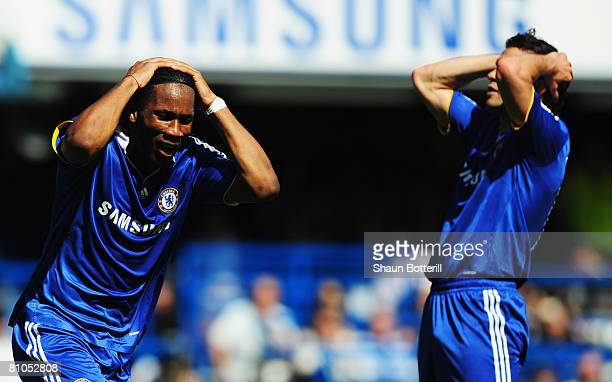 Didier Drogba and Michael Ballack of Chelsea react during the Barclays Premier League match between Chelsea and Bolton Wanderers at Stamford Bridge...