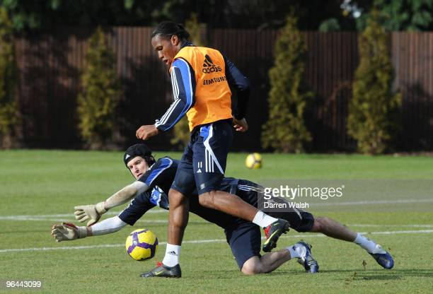Didier Drogba and Petr Cech of Chelsea during a training session at the Cobham Training Ground on February 5, 2010 in Cobham, United Kingdom.
