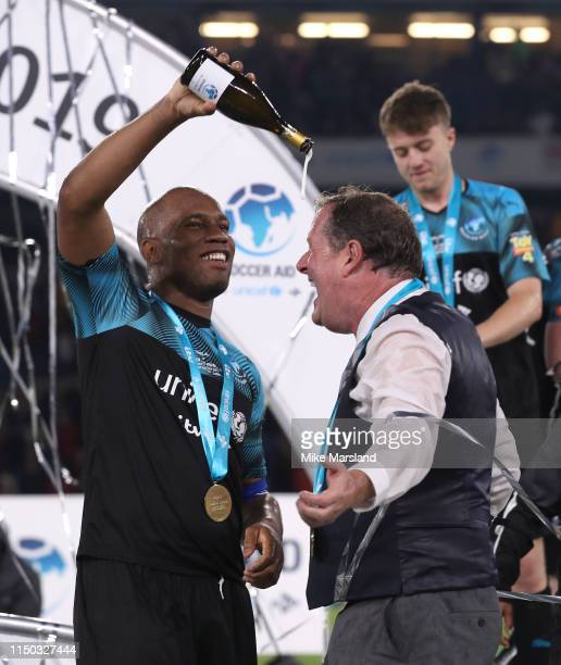 Didier Drogba and Piers Morgan during Soccer Aid 2019 at Stamford Bridge on June 16 2019 in London England