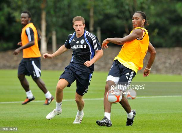Didier Drogba and Sam Hutchinson of Chelsea during training at the Cobham Training ground on August 5 2009 in Cobham Surrey