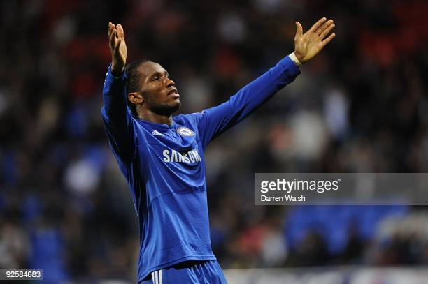Didier Drogba celebrate's Chelsea's fourth goal during the Barclays Premier League match between Bolton and Chelsea at the Reebok Stadium on October...