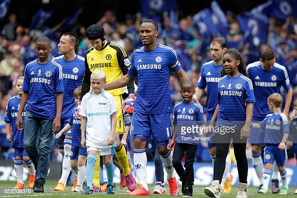 Didier Drogba is made captain for the day and leads his team out with his children on his last appearence for the club during the Chelsea v...