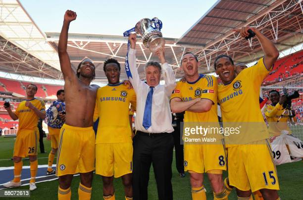 Didier Drogba John Obi Mikel manager Guus Hiddink Frank Lampard and Florent Malouda of Chelsea celebrate with the trophy after the FA Cup sponsored...