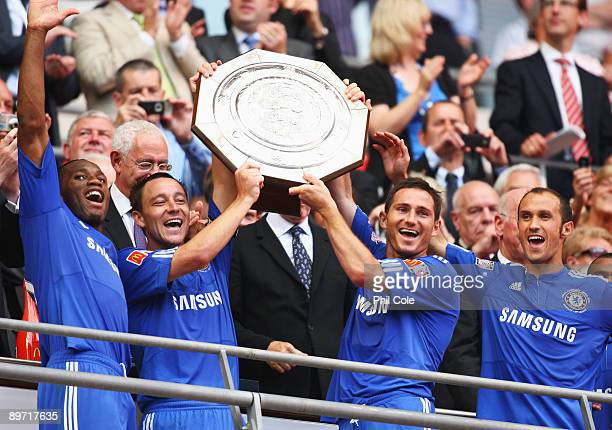 Didier Drogba John Terry Frank Lampard and Ricardo Carvalho of Chelsea celebrate with the trophy after victory during the FA Community Shield match...