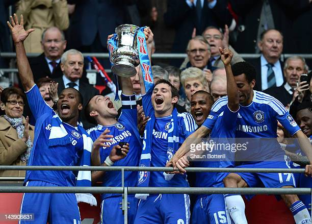 Didier Drogba John Terry Frank Lampard Florent Malouda and Jose Bosingwa of Chelsea lift the FA Cup trophy during the FA Cup with Budweiser Final...