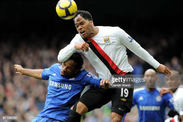Didier Drogba of Chelsea and Joleon Lescott of Manchester City battle for the header during the Barclays Premier League match between Chelsea and...