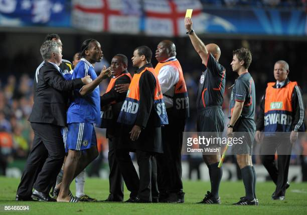 Didier Drogba of Chelsea argues with the referee in front of caretaker manager of Chelsea Guus Hiddink after the UEFA Champions League Semi Final...