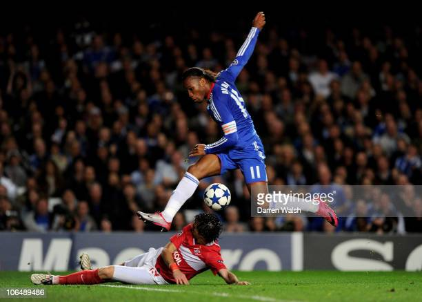 Didier Drogba of Chelsea attempts a shot on goal past Nicolas Pareja of Spartak Moscow during the UEFA Champions League group F match between Chelsea...
