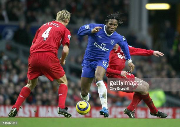 Didier Drogba of Chelsea attempts to move past Sami Hyypia of Liverpool during the Barclays Premiership match between Liverpool and Chelsea at...