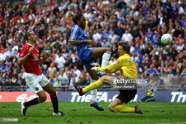 Didier Drogba of Chelsea beats Edwin Van der Sar of Manchester United to score their first goal during the FA Cup Final match sponsored by EON...