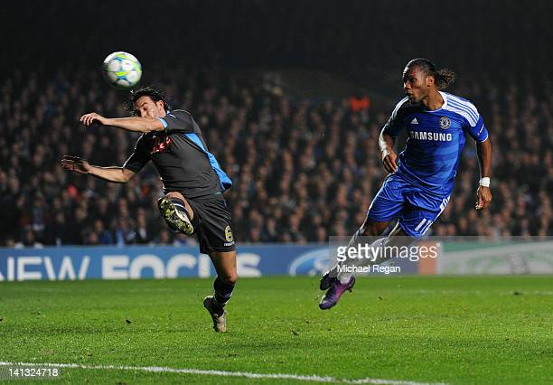 Didier Drogba of Chelsea beats Salvatore Aronica of Napoli to score their first goal with a header during the UEFA Champions League Round of 16...