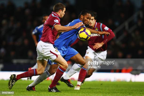 Didier Drogba of Chelsea breaks through the West Ham United defence during the Barclays Premier League match between West Ham United and Chelsea at...