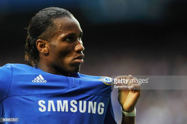 Didier Drogba of Chelsea celebrates after scoring his team's third goal during the Barclays Premier League match between Chelsea and Tottenham...