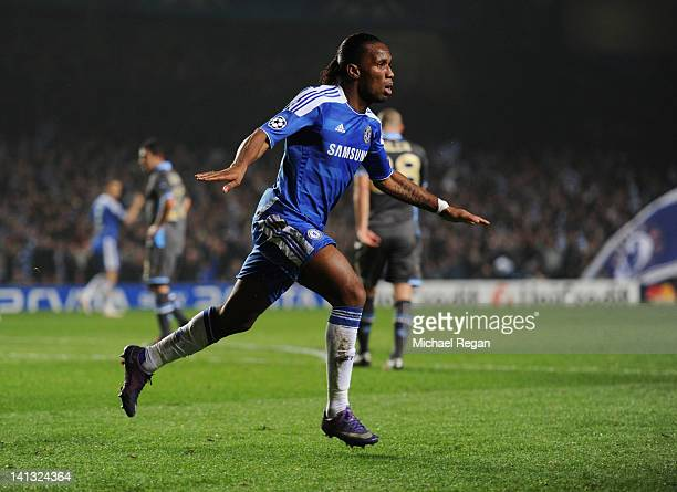 Didier Drogba of Chelsea celebrates as he scores their first goal with a header during the UEFA Champions League Round of 16 second leg match between...