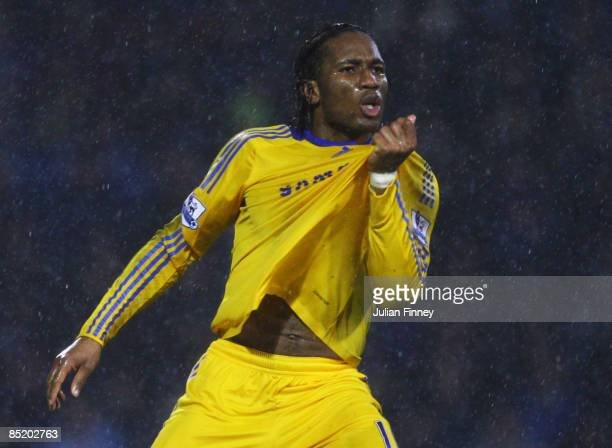 Didier Drogba of Chelsea celebrates as he scores their first goal during the Barclays Premier League match between Portsmouth and Chelsea at Fratton...