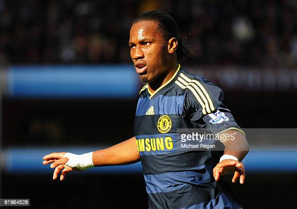Didier Drogba of Chelsea celebrates as he scores their first goal during the Barclays Premier League match between Aston Villa and Chelsea at Villa...