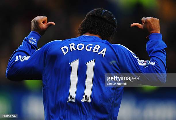 Didier Drogba of Chelsea celebrates as he scores their second goal during the Barclays Premier League match between Chelsea and Arsenal at Stamford...