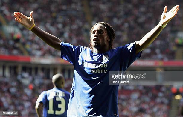Didier Drogba of Chelsea celebrates his second goal during the FA Community Shield match between Arsenal and Chelsea held at the Millennium Stadium...
