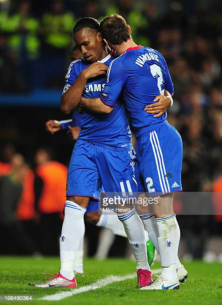 Didier Drogba of Chelsea celebrates scoring his penalty kick with Branislav Ivanovic during the UEFA Champions League Group F match between Chelsea...