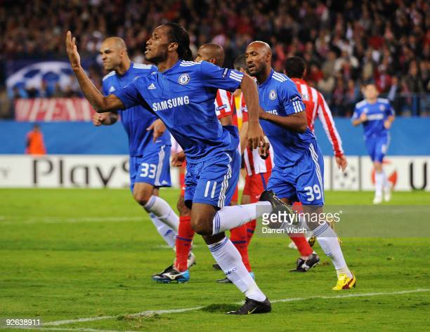 Didier Drogba of Chelsea celebrates scoring his teams first goal of the game during Champions League Group D match between Atletico Madrid and...