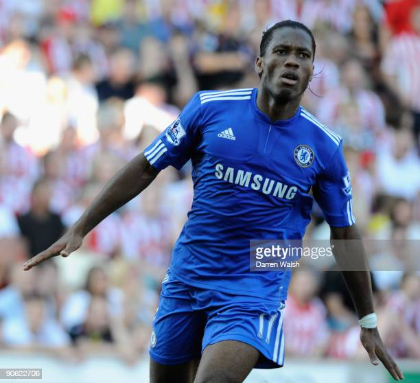 Didier Drogba of Chelsea celebrates scoring his team's first goal during the Barclays Premier League match between Stoke City and Chelsea at the...