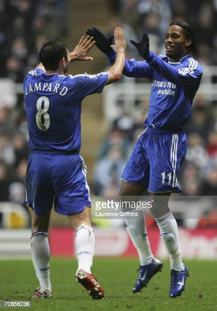 Didier Drogba of Chelsea celebrates scoring his team's first goal with team mate Frank Lampard during the Carling Cup quarter final match between...