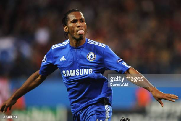Didier Drogba of Chelsea celebrates scoring his teams second goal of the game during Champions League Group D match between Atletico Madrid and...