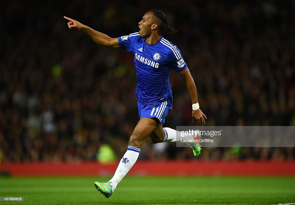 Didier Drogba of Chelsea celebrates scoring the first goal during the Barclays Premier League match between Manchester United and Chelsea at Old Trafford on October 26, 2014 in Manchester, England.