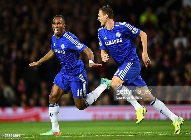 Didier Drogba of Chelsea celebrates scoring the first goal with teammate Nemanja Matic during the Barclays Premier League match between Manchester...