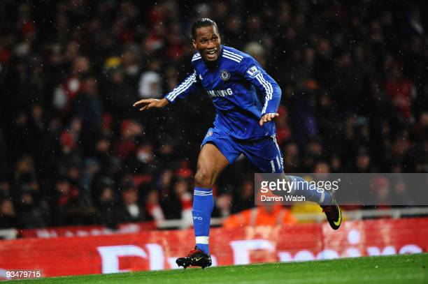 Didier Drogba of Chelsea celebrates scoring the opening goal during the Barclays Premier League match between Arsenal and Chelsea at the Emirates...