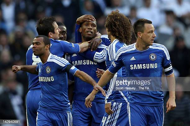 Didier Drogba of Chelsea celebrates scoring the opening goal with his team mates during the FA Cup with Budweiser Semi Final match between Tottenham...