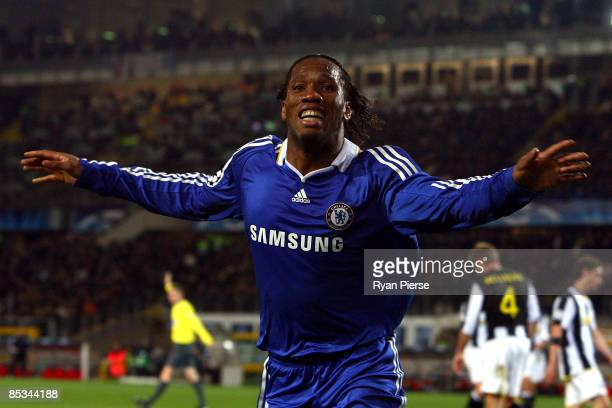 Didier Drogba of Chelsea celebrates scoring the second goal of the game for his team during the UEFA Champions League, First knock-out round, second...