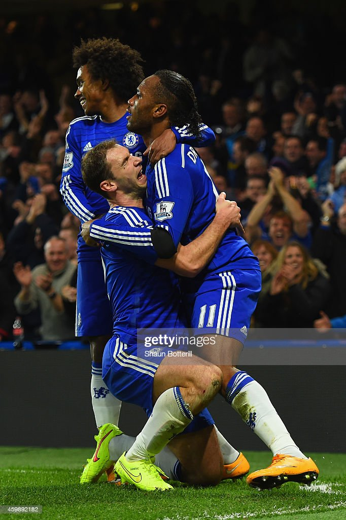Didier Drogba of Chelsea celebrates scoring their second goal with Branislav Ivanovic and Willian of Chelsea during the Barclays Premier League match between Chelsea and Tottenham Hotspur at Stamford Bridge on December 3, 2014 in London, England.