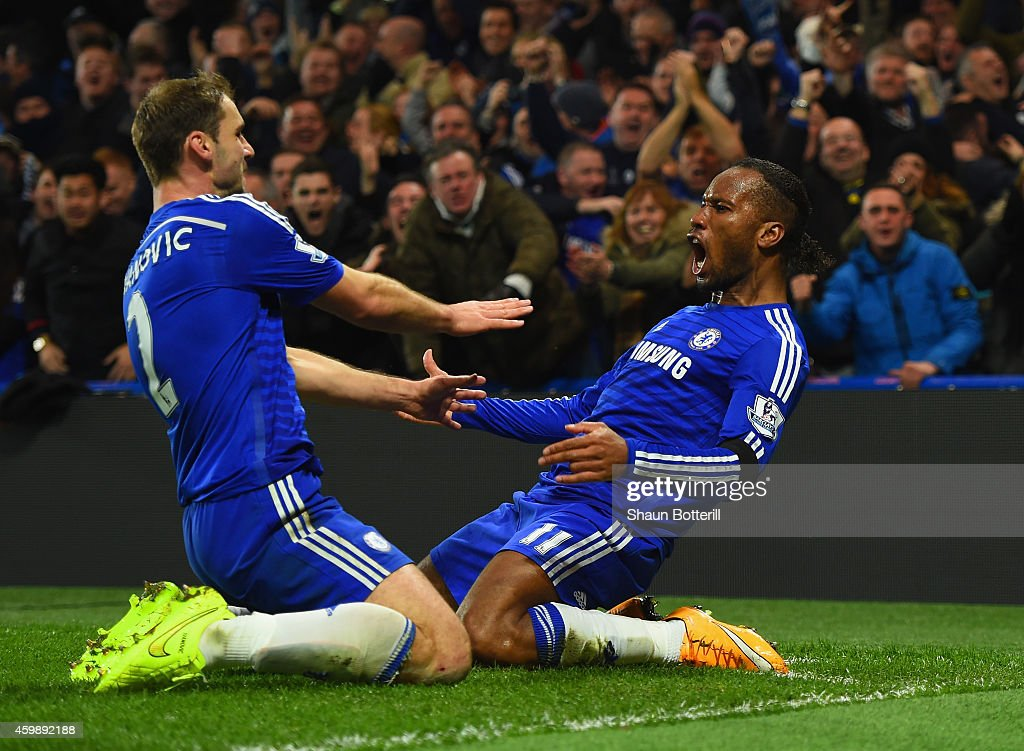 Didier Drogba of Chelsea celebrates scoring their second goal with Branislav Ivanovic of Chelsea during the Barclays Premier League match between Chelsea and Tottenham Hotspur at Stamford Bridge on December 3, 2014 in London, England.
