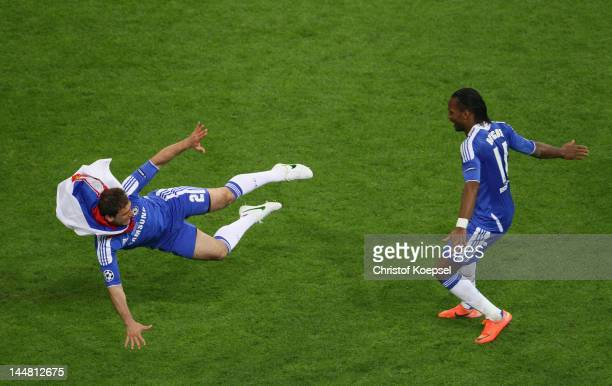 Didier Drogba of Chelsea celebrates with Branislav Ivanovic after scoring the winning penalty during UEFA Champions League Final between FC Bayern...
